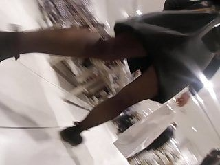 Candid milf in ebon hose shoping