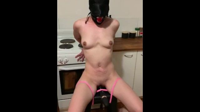 Fastened serf gagged with sextoy castigation