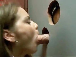 Great yielding hotty engulfing at gloryhole in sexshop.