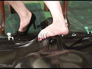 Japanese femdom facesitting and foot fetish to rubber serf
