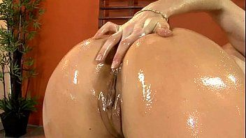 Oiled up sweetheart pumping in dark fishnet nylons