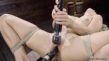 Blond in rope slavery machine drilled