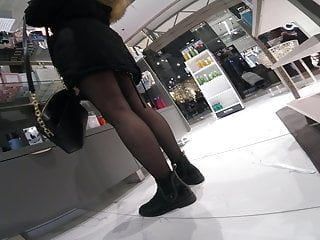 Candid legal age teenager in darksome hose shoping