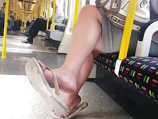 Candid good feet in flip flops on tube faceshot